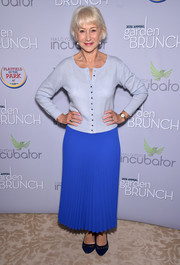 Helen Mirren paired her cardigan with a pleated maxi skirt in a deeper shade of blue.