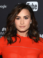 Demi Lovato injected some sparkle with a pair of diamond studs.