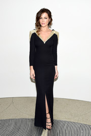 Kate Beckinsale polished off her look with strappy black heels.