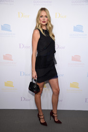 For her bag, Lindsay Ellingson picked a multicolored satin purse by Dior.