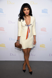 Kiersey Clemons looked alluring in a Dior LWD with a plunging neckline and colorful ribbon detailing while attending the 2016 Guggenheim International pre-party.