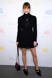 Makenzie Leigh was menswear-chic in a black tuxedo dress by Christian Dior at the 2016 Guggenheim International pre-party.