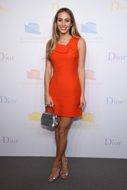 Harley Viera-Newton opted for silver accessories, including an elegant sequined purse by Dior.