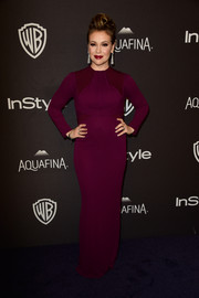 Alyssa Milano was all about simple elegance in a long-sleeve burgundy column dress at the InStyle and Warner Bros. Golden Globes post-party.