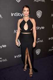 Bellamy Young got risque in a multi-cutout, high-slit black gown by Solace London for the InStyle and Warner Bros. Golden Globes post-party.