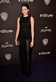 Margaret Qualley looked subtly sexy in a see-through black gown at the InStyle and Warner Bros. Golden Globes post-party.