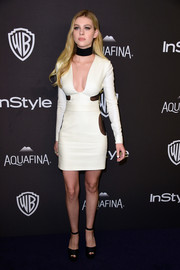 Nicola Peltz was mod and sexy in a low-cut white mini dress with sheer black panels at the InStyle and Warner Bros. Golden Globes post-party.