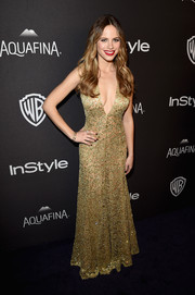 Halston Sage took a daring plunge in this metallic lace dress by Michael Kors when she attended the InStyle and Warner Bros. Golden Globes post-party.