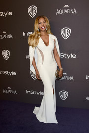 Laverne Cox made a regal entrance at the InStyle and Warner Bros. Golden Globes post-party in a caped white Mark Zunino gown with illusion cutouts and a high front slit.