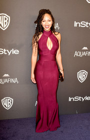 Meagan Good put on an impressive display of curves in a form-fitting burgundy cutout dress by House of CB at the InStyle and Warner Bros. Golden Globes post-party.