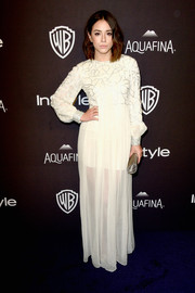 Chloe Bennet went boho-glam in a loose, long-sleeve white gown with an embellished bodice for the InStyle and Warner Bros. Golden Globes post-party.