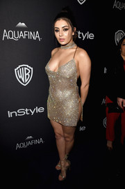 Charli XCX matched her super-sexy dress with gold Stuart Weitzman Legwrap sandals.