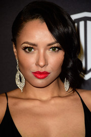 Kat Graham brightened up her beauty look with a swipe of bold red lipstick.