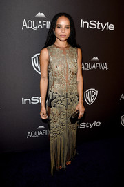 Zoe Kravitz dared to (almost) bare in a sheer sequin gown by Alexander McQueen for the InStyle and Warner Bros. Golden Globes post-party.