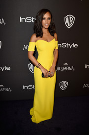 Serayah McNeill was a burst of sunshine in a bright yellow off-the-shoulder gown by Safiyaa at the InStyle and Warner Bros. Golden Globes post-party.