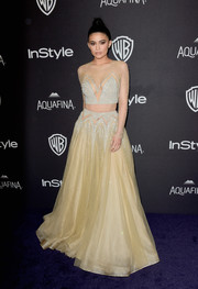 Kylie Jenner chose a two-piece Labourjoisie look with pearl and crystal embellishments over a nude illusion maxi skirt for the 2016 Golden Globes after party.