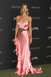 Rosie Huntington-Whiteley matched her gown with a pink satin clutch, also by Gucci.