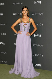 Alessandra Ambrosio enchanted in a lavender Gucci gown with a ruched, floral-embellished bodice at the 2016 LACMA Art + Film Gala.