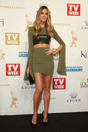 Jennifer Hawkins flaunted her toned abs at the Logie Awards in an army-green and black Alex Perry mini dress with an illusion cutout along the midsection.