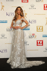 Delta Goodrem looked magical at the Logie Awards in a floral-embroidered white gown by Paolo Sebastian.