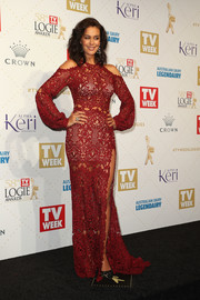 Megan Gale rocked the cold-shoulder trend with this burgundy lace gown by Paolo Sebastian at the Logie Awards.
