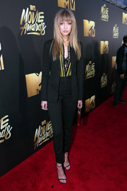 Gigi Hadid went business-chic in a black pinstriped suit by Versace for the MTV Movie Awards.