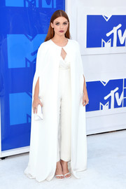Holland Roden layered a floor-sweeping white cape over a matching jumpsuit for her 2016 MTV VMA look.