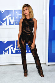 Hailey Baldwin struck the perfect balance between sexy and elegant with this sheer, feather-beaded jumpsuit by Georges Chakra at the 2016 MTV VMAs.
