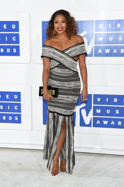Alicia Quarles chose a cool pair of PVC ankle-strap heels to complete her outfit.