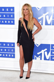Britney Spears paired her ultra-modern dress with classic black pumps by Christian Louboutin.