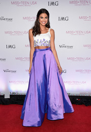 Katherine Haik rounded out her look with an iridescent purple maxi skirt.