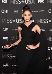 Pia Wurtzback paired a geometric black clutch with a caped gown for her 2016 Miss USA red carpet look.