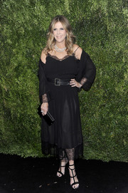 Rita Wilson continued the sultry vibe with a pair of black gladiator heels.