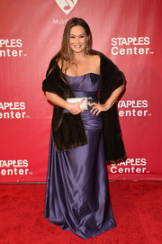 Tia Carrere went glam in a strapless purple gown styled with a brown fur stole at the MusiCares Person of the Year event.