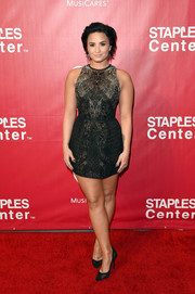 Demi Lovato completed her outfit with black mesh-panel pumps by Giuseppe Zanotti.