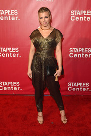Kimberly Perry looked exotic in a gold harem-style jumpsuit while attending the MusiCares Person of the Year event.