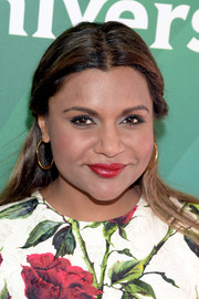 Mindy Kaling looked demure wearing this half-up hairstyle at the 2016 NBCUniversal Summer Press Day.
