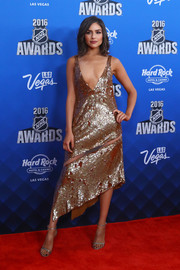 Olivia Culpo kept the shimmer going with a pair of silver Stuart Weitzman sandals.