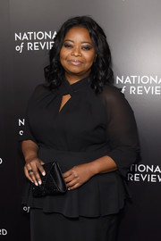 Octavia Spencer carried an on-trend envelope clutch by Tyler Ellis when she attended the National Board of Review Gala.