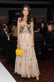 Leandra Medine got all dolled up in a tiered, bird-print gown with flower-adorned shoulder straps for the 2016 Parsons Benefit.