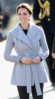 Kate Middleton kept warm in style with this gray Sentaler alpaca/wool coat with ribbed sleeves while visiting Carcross during the Royal Tour of Canada.