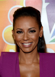 Melanie Brown styled her hair into a sleek half-up 'do with a pompadour top for the NBCUniversal Summer TCA Tour.