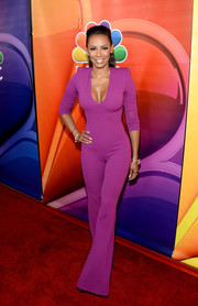 Melanie Brown's curve-hugging purple jumpsuit did an excellent job of showing off her fabulous figure!