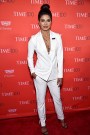 Priyanka Chopra was androgy-sexy in a plunging white ST. Studio by Olcay Gulsen pantsuit at the Time 100 Gala.