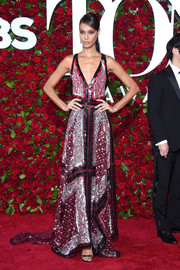 Joan Smalls donned an Altuzarra handerchief gown, in two shades of red with black and silver sequins, for the 2016 Tony Awards.