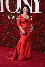 Gloria Estefan looked regal in a red corset gown with a long train at the 2016 Tony Awards.