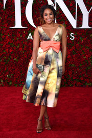Alicia Quarles oozed sweetness in this colorful bow-adorned print dress at the 2016 Tony Awards.