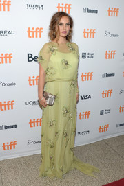 Natalie Portman looked downright divine in a beaded lime-green gown by Prada during the TIFF premiere of 'Jackie.'