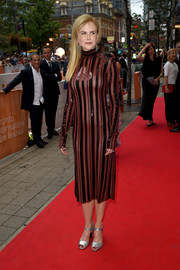 Nicole Kidman highlighted her svelte physique in this burgundy sequin-striped dress by Nina Ricci during the TIFF premiere of 'Lion.'