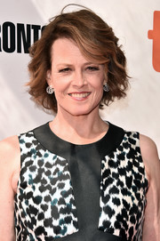 Sigourney Weaver attended the TIFF premiere of 'A Monster Calls' wearing her hair in a wavy bob.